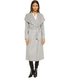 Le cache-poussière, un manteau ample